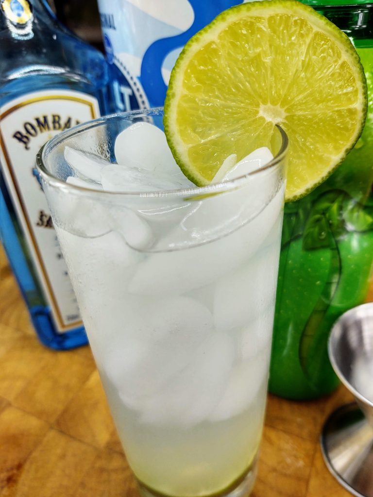 Gin Rickey in highball with lime wheel